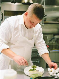 Chef Matt Gaudet Preparing A Dish At Freepoint Kitchen & Cocktails